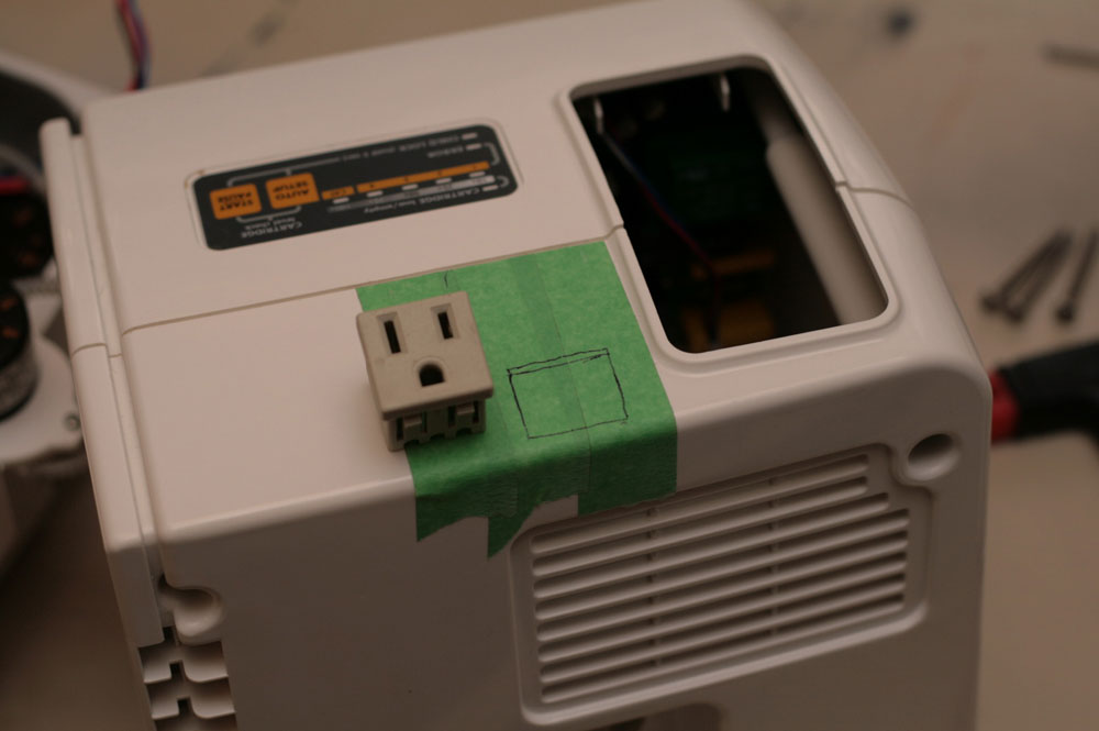 find a location where your power socket will fit nicely and mark it with tape - Catgenie Com